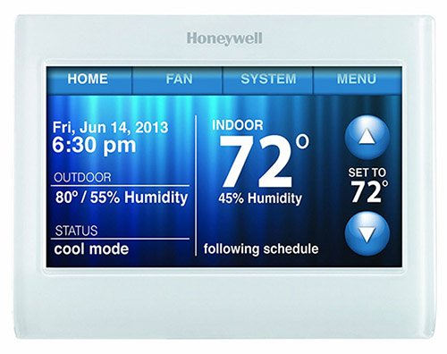 Heat pump thermostat with touchscreen
